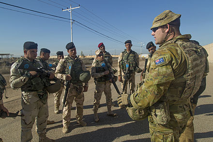 An Australian soldier with Iraqi soldiers during a training exercise in November 2015 An Australian soldier assigned to Task Group Taji conducts an after action review with Iraqi soldiers assigned to 71st Iraqi Army Brigade at Camp Taji in November 2015.jpg