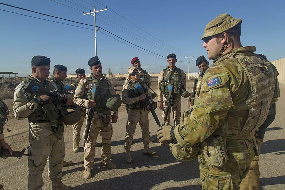 An Australian soldier assigned to Task Group Taji conducts an after action review with Iraqi soldiers assigned to 71st Iraqi Army Brigade at Camp Taji in November 2015