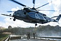 An MH-53E helicopter transports a concrete barrier to help repair the Dam in Puerto Rico. (37568195986).jpg