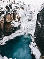 An icy stream between cliffs (Unsplash).jpg