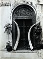An ornate carved doorway in Zanzibar, with an enormous pair Wellcome V0048591.jpg