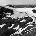 Aniakchak Crater and Rim Glacier, terminus of mountain glacier and firn line on rim of valley wall, August 24, 1960 (GLACIERS 7063).jpg