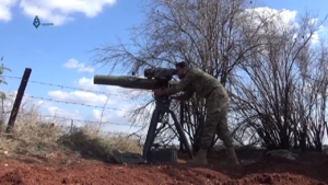Jaysh al-Izza - An Army of Glory fighter launches a BGM-71 TOW anti-tank missile at a Syrian government position during the 2017 Hama offensive.