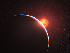Gliese 1214 b - Artist's impression of GJ 1214 b (foreground), illuminated by the red light of its parent star (center)'