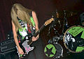 Avril playing guitar, Brazil (crop).jpg