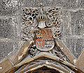 Bad Urach St Amandus Portal Wappen.jpg
