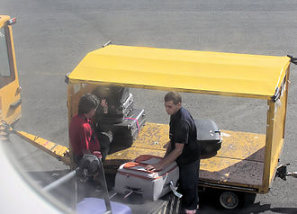 Baggage handling system - Baggage being loaded onto the conveyor of an EasyJet Airbus A319