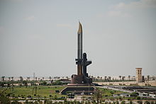 A towering monument resembling a bayonet