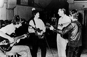 Revolver (Beatles album) - Harrison, McCartney and Lennon with George Martin at EMI Studios in the mid 1960s