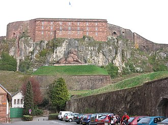 Fortified region of Belfort - The Lion of Belfort, symbolic of the defense of Belfort in 1870–71, with the citadel behind