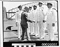Billy Hughes inspecting the crew of HMAS SYDNEY (II) with Captain John Augustine Collins. From left to right- LCDR E W Thruston (partially obscured), LCDR J C Bacon, LCDR C C Montgomery, LCDR M M (3294141952).jpg