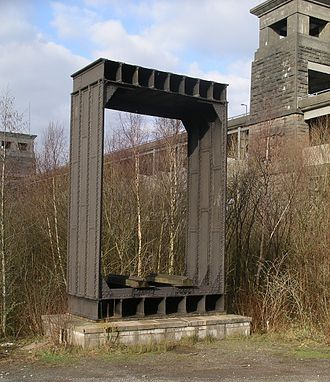 Tubular bridge - Section of the original wrought-iron tubular Britannia Bridge standing in front of the modern bridge