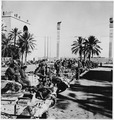 British tanks and crews line up on Tripoli's waterfront after capturing the city. - NARA - 196346.tif