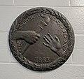 Buckingham and Nichols School bas-relief seal by Cyrus Dallin.jpg