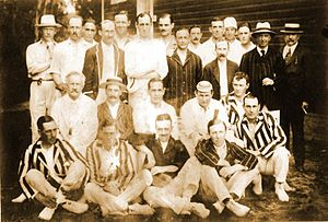 Buenos Aires Cricket & Rugby Club - Buenos Aires and Rosario C.C. players posing together during a cricket match, 1916.