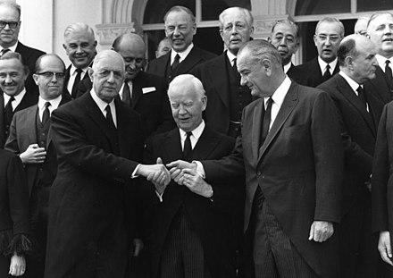 De Gaulle and Lyndon B. Johnson meeting at Konrad Adenauer's funeral in 1967, with President of West Germany Heinrich Lübke (center)