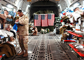Wounded U.S. personnel flown from Iraq to Ramstein, Germany, for medical treatment (February 2007) C-17 Medevac mission, Balad AB, Iraq.jpg