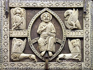 Christ in Majesty - Christ in majesty in a mandorla, surrounded by emblems of the evangelists: ivory plaques on a wooden coffret, Cologne, first half of the 13th century (Musée de Cluny)