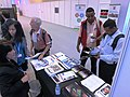 COP-18 Delegates View NASA Publications (8230309422).jpg