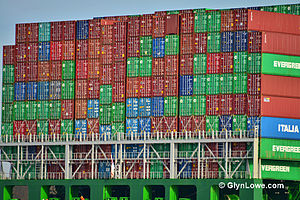 Italia Marittima - ITALIA containers (in blue) mixed in with Evergreen containers (in green) on a ship.