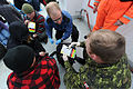 Canadian air force Capt. Ryan McCallum, center, a medical officer, and Canadian Army Sgt. Glenn Striker, right, a medical technician, assess casualties aboard R-V Strait Hunter, which was simulating a migrant 120508-N-IL267-109.jpg