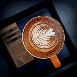 "Latte art - An example of a ""tulip""- a common type of latte art invented by Luigi Lupi 2004 in Greece."