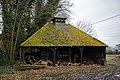 Cart lodge with dovecote north from St Peter's Church, Shelley, Essex.jpg