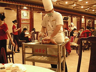 Quanjude - Serving up a roast duck in Beijing, China