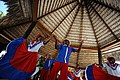 Catalina Island, La Romana, Dominican Republic. Men and women in traditional clothes are performing a dance under bungalow roof. (reportage).jpg
