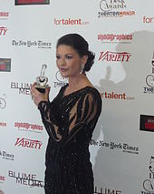 Catherine Zeta-Jones posing with an award