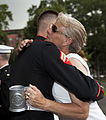 Cheryl Wankum, right, mother of honorary Marine Daran Wankum, not shown, hugs a Marine corporal following a wreath laying ceremony at the Marine Corps War Memorial in Arlington, Va, June 13, 2013 130613-M-KS211-031.jpg