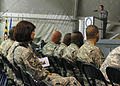 Chief Master Sgt. Stephanie Cardozo with Joint Task Force MED east-455th Expeditionary Medical Group, listens to Army Sgt. First Class Raleigh Sell, the protocol non-commissioned officer in charge DVIDS222445.jpg