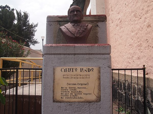 Bust of composer Quirino Mendoza y Cortes with plaque showing measures of the song and lyrics. Cielito Lindo Statue Palacio Municipal Tulyehualco.jpg