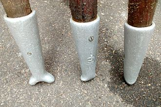 Punt (boat) - Three punt pole shoes in varying states of wear