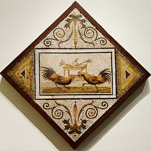 Cockfight - In this ancient Roman mosaic, two cocks face off in front of a table displaying the purse for the winner between a caduceus and a palm of victory (National Archaeological Museum of Naples)