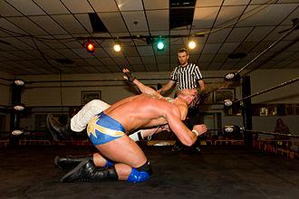 Cody Deaner - Deaner hitting a DDT on a kneeling Shawn Spears.