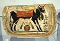 Coffin footboard. The Apis bull appears. Apis protected the dead on their way to the underworld. Egypt. 8th to 4th century BCE. National Museum of Scotland, Edinburgh.jpg