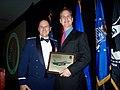 Col. Randy Falcon presents a wing plaque to U.S. Rep. Mario Diaz-Balart.jpg