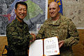 Col. Wankyu Choi, Republic of Korea Provincial Reconstruction Force commander, presents Col. Erik Rundquist, 455th Expeditionary Mission Support Group commander, with the ROK Joint Chiefs of Staff Certificate of Commendation.jpg