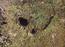 I Colli Albani in una foto satellitare: si notino l'altura di Monte Cavo con il lago Albano ed il lago di Nemi.