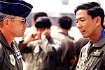 Colonel William Burnette, deployment commander, converses with Wing Commander Putti, Royal Thai Air Force, at the opening ceremony for joint US-Royal Thai Air Force Exercise COMMANDO WEST 89-1.jpg