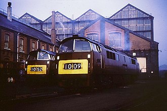"Swindon Works - ""Western"" diesel-hydraulic locomotives D1052 and D1009 in ex-works condition outside the main works buildings"