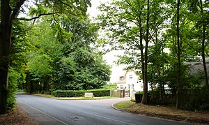 Darley Stud - An entrance to Dalham Hall Stud, part of Darley Stud in Newmarket, Suffolk, UK