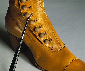 Buttonhook - A buttonhook in use on a c.1900 boot