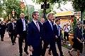 Danish Foreign Minister Jensen and Tivoli Gardens CEO Poulson Escort Secretary Kerry Through Tivoli Gardens in Copenhagen (27117120483).jpg
