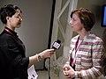 Danmarks miljominister och minister for nordisk samarbete intervjuas av kinesisk tv i Shanghai.jpg