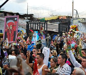 Tepito - The raising Santa Muerte images during a service for Santa Muerte in Tepito.