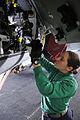 Defense.gov News Photo 110406-N-EE987-569 - U.S. Navy Petty Officer 2nd Class Adrian Ostolski sprays corrosion preventive compound into the avionics bay of an F A-18F Super Hornet aircraft.jpg