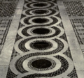 Detail of cosmati pavement, San Clemente, Rome.png