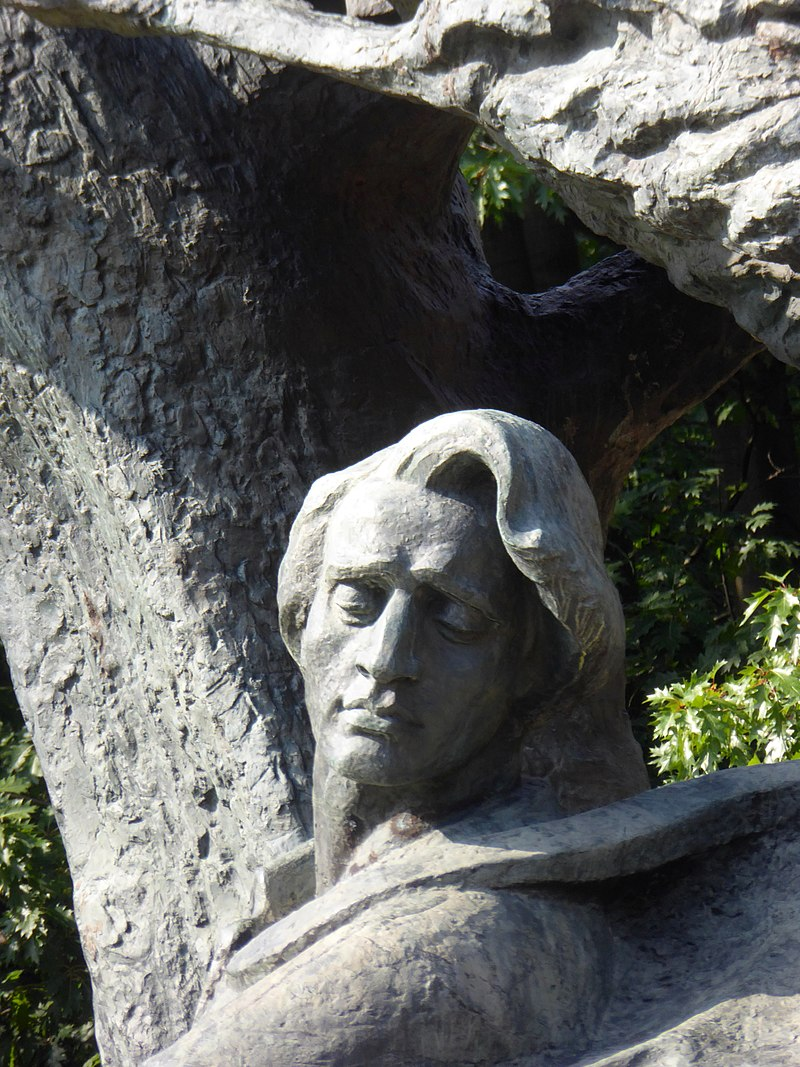Detail of the Chopin Monument in Łazienki Park.jpg